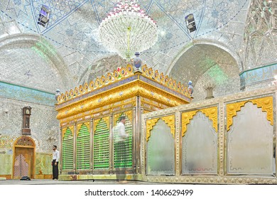 YAZD, IRAN - NOVEMBER 18, 2018 - Sanctuary with a holy tomb inside the Imam Zadeh Jafar shrine, with an example of intricate mirror works, reflecting light