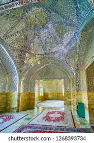 YAZD, IRAN - OCTOBER 18, 2017: The dome and walls in corridor of the modern shrine of Imam Zadeh Jafar are covered with fine mirrorwork, traditional for Shia cult buildings, on October 18 in Yazd.