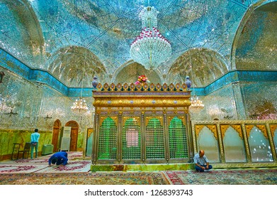 YAZD, IRAN - OCTOBER 18, 2017: The muslims at pray in richly decorated Shrine of Imamzadeh Jafar, famous for its outstanding mirror ornaments, on October 18 in Yazd.