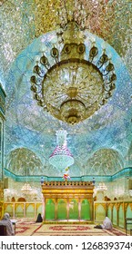 YAZD, IRAN - OCTOBER 18, 2017: Impressive women's prayer hall of Imam Zadeh Jafar Shrine with a view on mausoleum, mirror decorations and glass chandelier, on October 18 in Yazd.