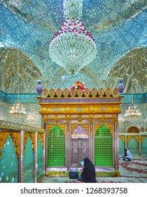 YAZD, IRAN - OCTOBER 18, 2017: The ornate interior of Imam Zadeh Jafar Mausoleum with shining mirror walls and dome, on October 18 in Yazd.