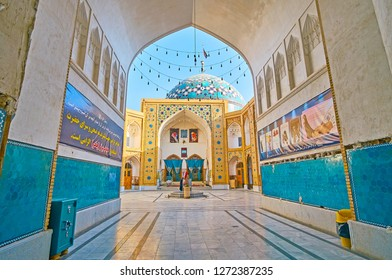 YAZD, IRAN - OCTOBER 18, 2017: Arched corridor to Imam Zadeh Jafar Shrine courtyard with ablution fountain, sceni iwan and dome, decorated with brickwork and Islamic patterns, on October 18 in Yazd.