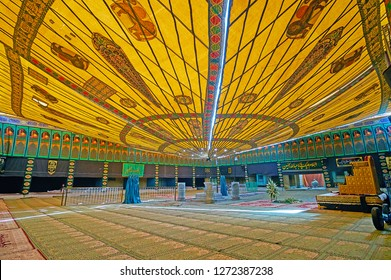 YAZD, IRAN - OCTOBER 18, 2017: Tent, decorated with Persian patterns and Lion and Sun emblem, in Imam Zadeh Jafar Shrine, it serves as the prayer hall during Ashura Festival, on October 18 in Yazd.
