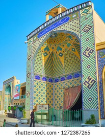 YAZD, IRAN - OCTOBER 18, 2017: One of the scenic portals of Imam Zadeh Jafar Shrine, decorated with beautiful mosaic patterns and Islamic calligraphy, on October 18 in Yazd.