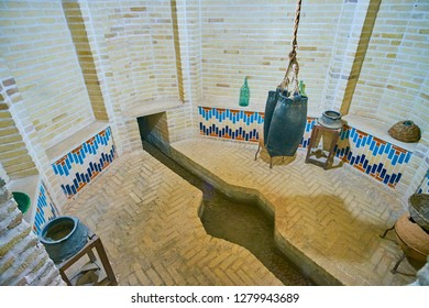 YAZD, IRAN - OCTOBER 18, 2017: Qanat runs through the underground room of Tehraniha House ( Fahadan Museum), such underground constructions provided cool water in olden times, on October 18 in Yazd