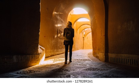 Yazd, Iran - October, 2018: Lazy tourist is strolling through sunny Yazd street labyrinth