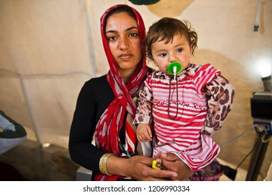 A Yazidi people who escaped abuse from ISIS outside her tent in Kanke refugee camp 17 MAY 2014. DOHUK, KURDISTAN, IRAQ -