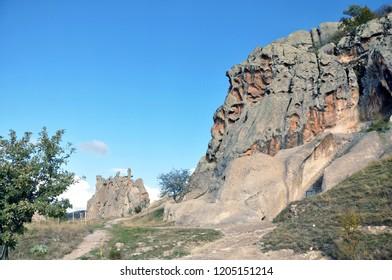 Yazilikaya, Phrygian Yazilikaya, or Midas Kenti (Midas city) which is Phrygian archaeological remains and inscription mentioning Midas.