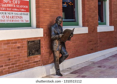 Ybor City Tampa Bay, Florida. January 19 , 2019  Roland Manteiga statue on Centro Espanol building background in 7th Ave.