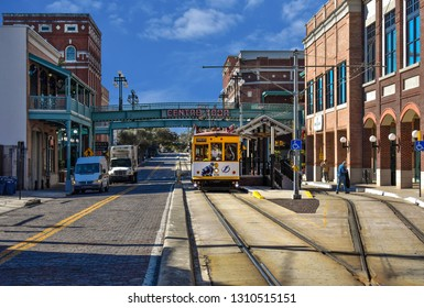 Ybor City Tampa Bay, Florida. January 19 , 2019  Centro Ybor Complex and colorful streetcar.  Ybor City  is a historic neighborhood in Tampa.  (1)