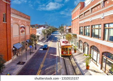Ybor City Tampa Bay, Florida. January 19 , 2019  . Top view of Street Car and vintage buildings in 8th ave on sky blue background.