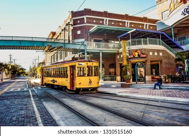 Ybor City Tampa Bay, Florida. January 19 , 2019  Centro Ybor Complex and colorful streetcar.  Ybor City  is a historic neighborhood in Tampa.