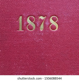 The year 1878 printed in gold on the red cloth binding of a yearbook published that year