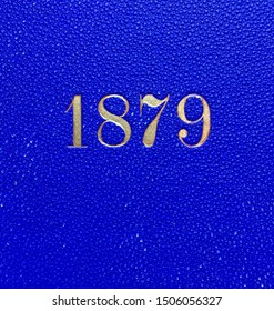 The year 1879 printed in gold on the blue cloth binding of a yearbook published that year