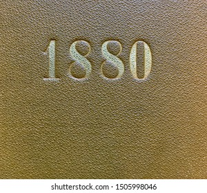 The year 1880 printed in gold on the brown cloth binding of a yearbook published that year