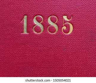 The year 1885 printed in gold on the red cloth binding of a yearbook published that year