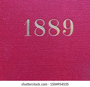 The year 1889 printed in gold on the red cloth binding of a yearbook published that year