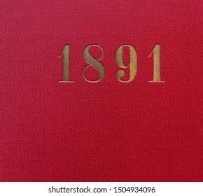 The year 1891 printed in gold on the red cloth binding of a yearbook published that year