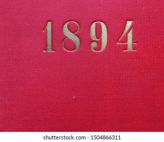 The year 1894 printed in gold on the red cloth binding of a yearbook published that year