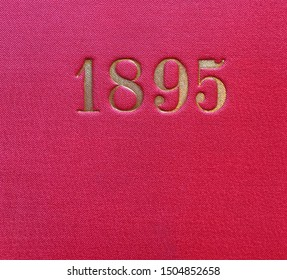 The year 1895 printed in gold on the red cloth binding of a yearbook published that year