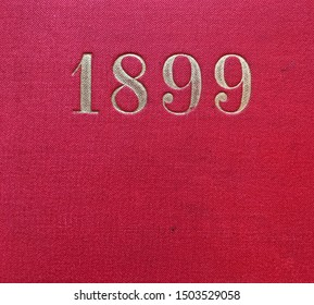 The year 1899 printed in gold on the red cloth binding of a yearbook published that year