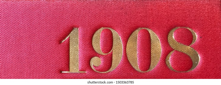 The year 1908 printed in gold on the red cloth binding of a yearbook published that year