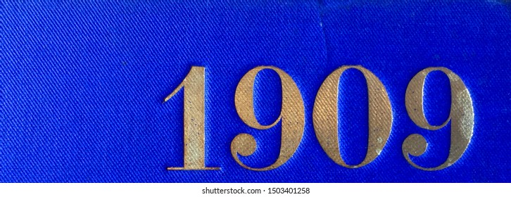 The year 1909 printed in gold on the blue cloth binding of a yearbook published that year