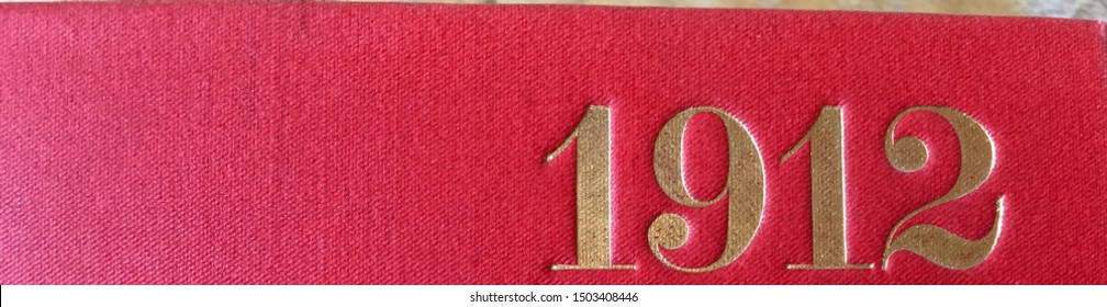 The year 1912 printed in gold on the red cloth binding of a yearbook published that year