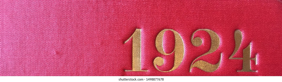 The year 1924 printed in gold on the red cloth binding of a yearbook published that year