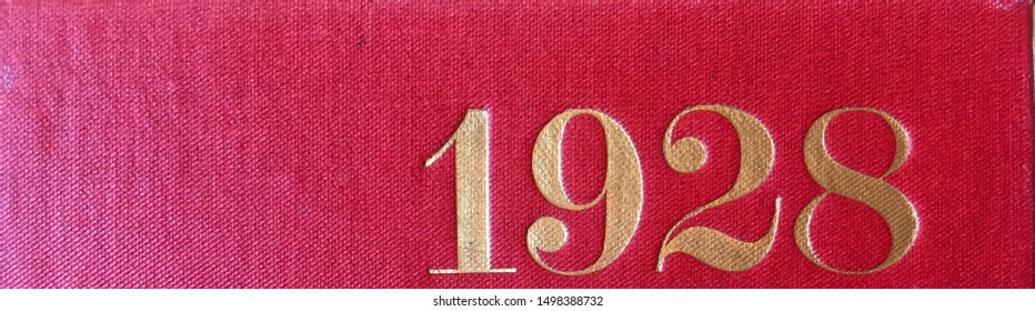 The year 1928 printed in gold on the red cloth binding of a yearbook published that year