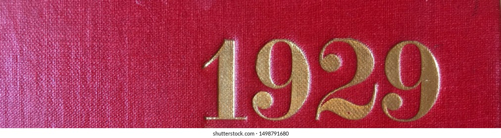 The year 1929 printed in gold on the red cloth binding of a yearbook published that year