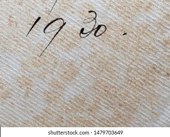 The year 1930 from a book owner's inscription. The structure of the paper is clearly visible, as is some foxing of the paper.