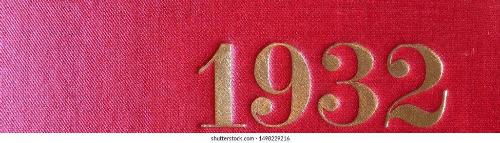 The year 1932 printed in gold on the red cloth binding of a yearbook published that year