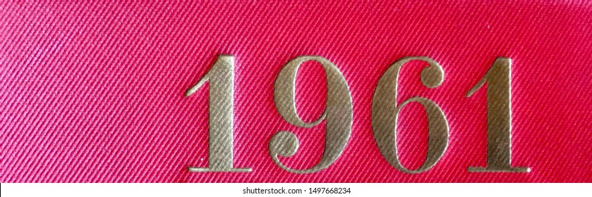 The year 1961 as printed in gold on the red cloth binding of a yearbook published that year