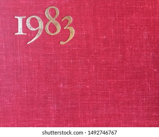 The year 1983 as printed in gold on the red cloth binding of a yearbook published that year