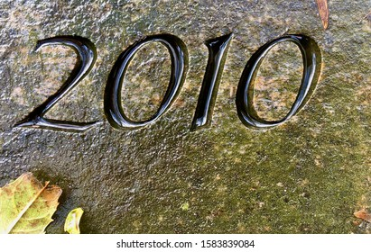 The year 2010 carved in granite on a rainy day – a detail of an inscription produced that year
