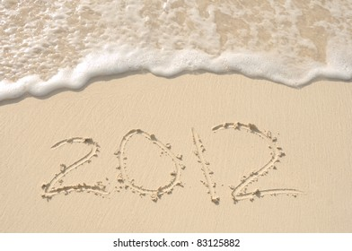 The Year 2012 Written in the Sand on a Beach