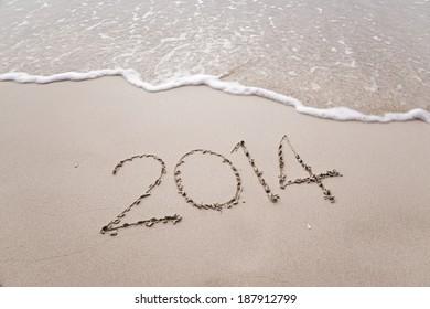 Year 2014 written in sand, on krabi beach ,Thailand