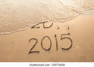 Year 2015 Coming written on the beach