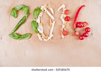 Year 2016 shape made of fresh ingredients peppers, basil, pasta and tomatoes, concept.