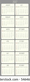 Year 2017 calendar. Beige rounded rectangles over gray background.