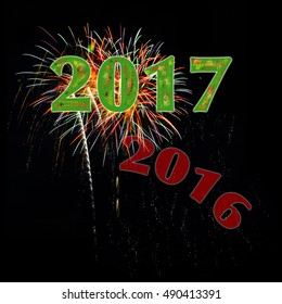 Year 2017 numbers with 2015 fading away over fireworks on black background for New Year's Day or New Year's Eve.
