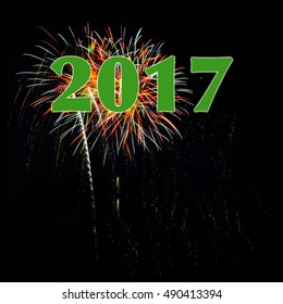 Year 2017 numbers over fireworks on black background for New Year's Day or New Year's Eve with copy space room for text below