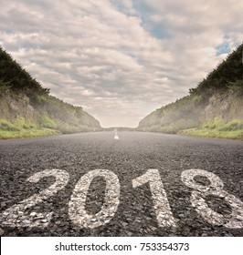 year 2018 painted on asphalt road