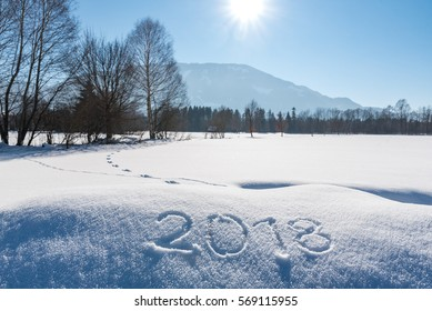 Year 2018 written at snow in Austrian Landscape