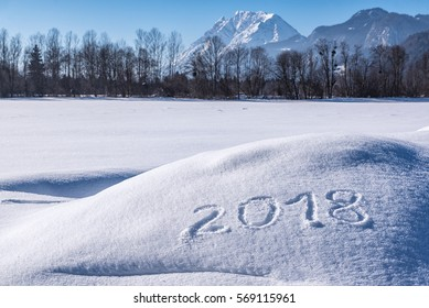 Year 2018 written in Snow with Austrian Alps in the Background
