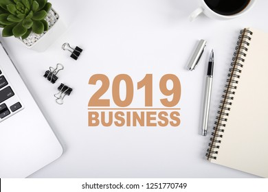 Year 2019 Business Concept on the top view workshop desktop table.