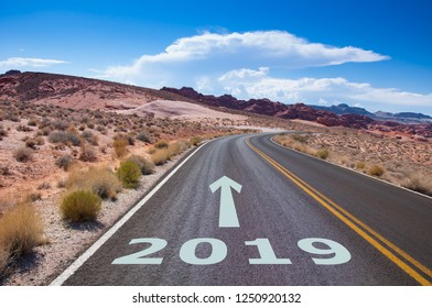 The year 2019  written on an empty street in the desert of Nevada, USA. An arrow is pointing into the future.