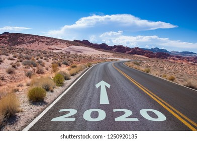 The year 2020  written on an empty street in the desert of Nevada, USA. An arrow is pointing into the future.