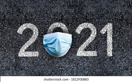 Year 2021 on asphalt road with Surgical Face Mask. happy new year 2021